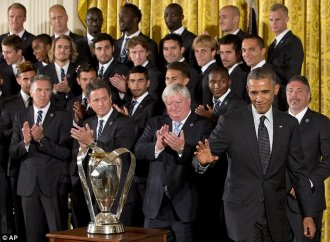 'Clearly something is going on in Kansas City': President Barack Obama waves after honoring the Sporting Kansas City soccer team during an event in the East Room of the White House