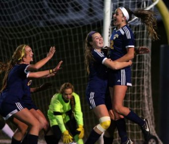 Massapequa's Melanie Hingher celebrates her first goal against