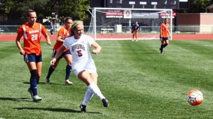 OSU freshman midfielder Arden Holden (5) passes the ball during a game against Bucknell on Sept. 13 at Jesse Owens Memorial Stadium. OSU won 2-0. Credit: Carlee Frank / For The Lantern
