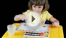 clip 1088733: Little girl playing with watercolors