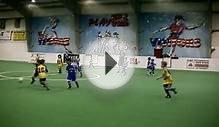 U7 Boy playing indoor soccer (football) and showing off